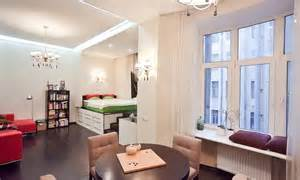 Beds For Studio Apartment Ideas Studio Apartment With A Raised Platform Bed And Wide Windowsills Home Interior Design Kitchen