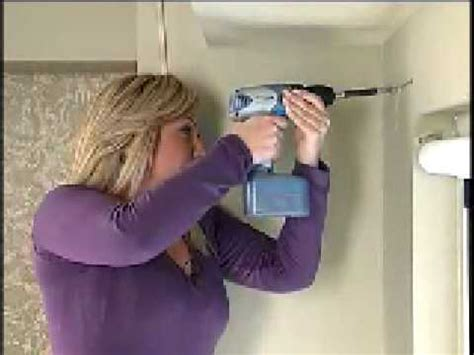 how to put curtain rods up how to hang a curtain rod with barbara k youtube