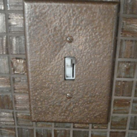 sockets and light switch plackets with rustoleum hammered paint in brown or bronze to match