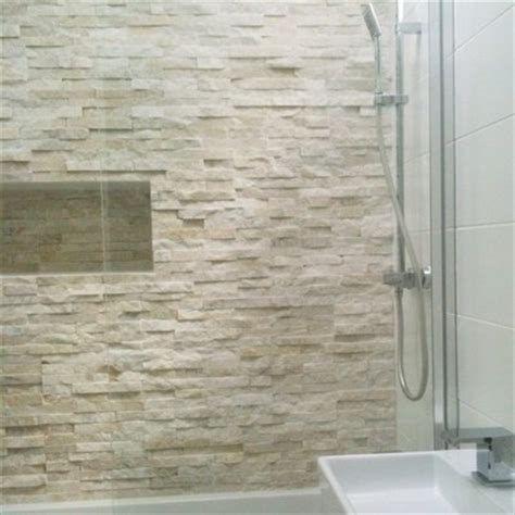 white stone bathroom tiles 25 best ideas about stone wall tiles on pinterest master bathroom designs artistic