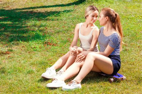 lesbian comfort two lesbians sitting on grass in park stock image image