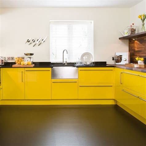 sink take a tour around a bright yellow kitchen