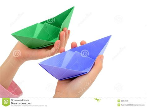 Origami Holding - holding origami boats royalty free stock photo image