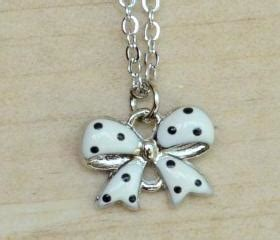 A Polka Dot Ribbon Necklace Inspired By Louis Vuitton Adds Chic To Any Ensemble Fashiontribes Fashion by Black Polka Dots On White Ribbon Necklace On Luulla