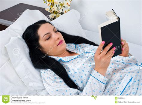 reading before bed woman reading in bed before sleep stock image image