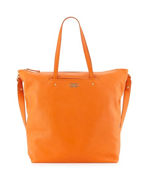 origami tote bag ferragamo aika gancini origami tote bag in orange lyst