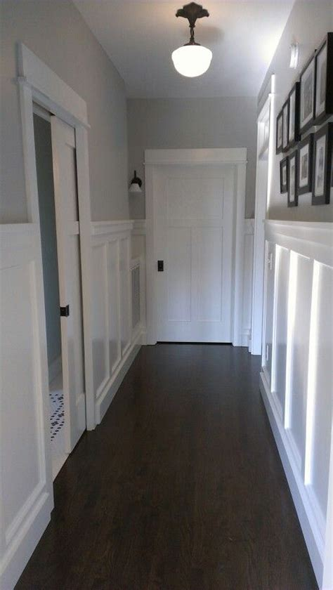 paneled walls sherwin williams paint color quot front porch quot rejuvenation pendant pocket door