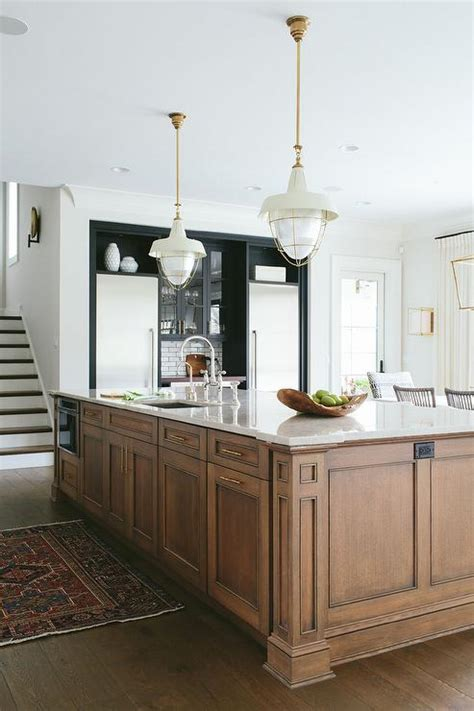 center kitchen island brown center island with brass pulls transitional kitchen
