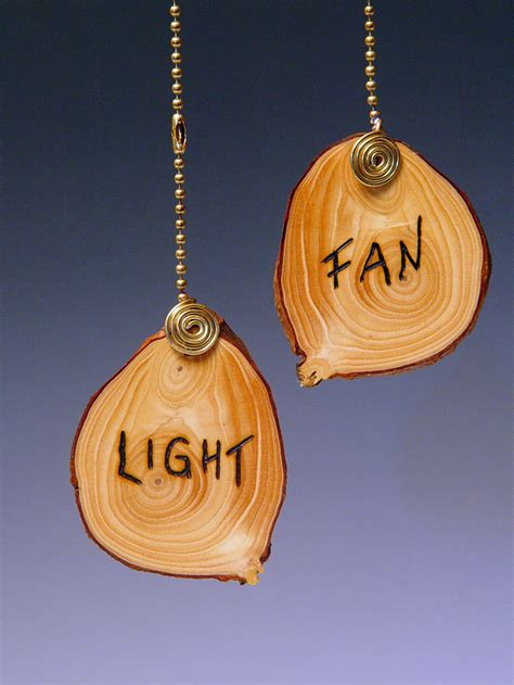 ceiling fan chain pulled out ceiling fan pull chain l pull wooden disc etched with
