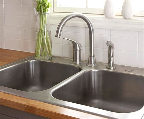 how to install faucet in kitchen sink how to install a sink and faucet