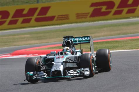 mclaren nationality lewis hamilton turns up the heat with jibe at nico rosberg