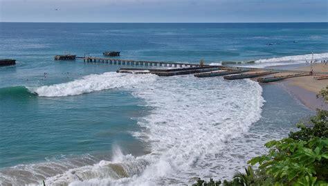 surfers enjoying the waves crash boat beach in aguadilla - Crash Boat Waves