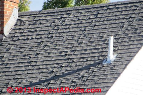 patterned roof felt shingle fishmouth curling as a sign of asphalt shingle