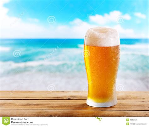 sea brewery glass of on wooden table sea stock photo image 49451536
