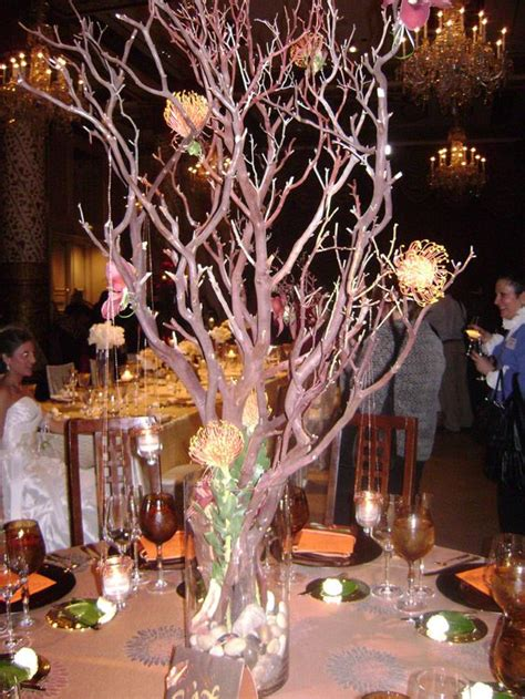 black manzanita tree centerpieces centerpieces manzanita tree branches in clear vase filled with rocks with hanging