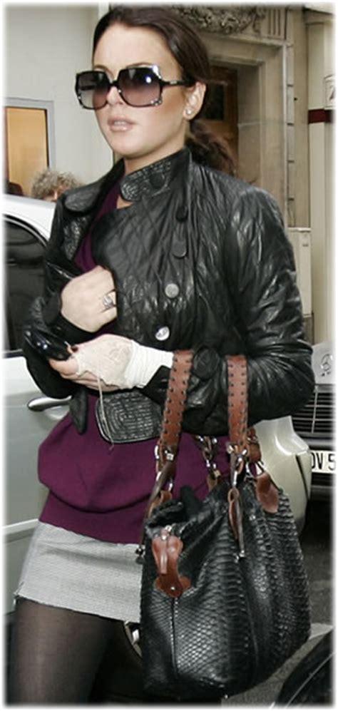 Name That Bag Lindsay Lohan Purses Designer Handbags And Reviews by Name Lindsay Lohan S Python Bag Purseblog