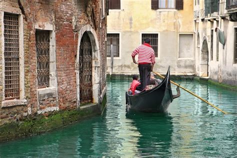 best place to get a gondola in venice venetian canal and gondola among houses in venice