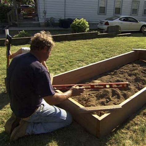 Step By Step Vegetable Garden Level The Frame How To Build A Raised Vegetable Garden