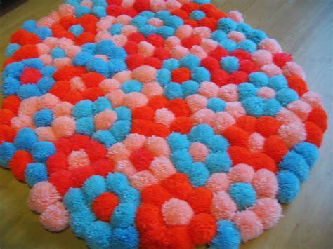 pom pom rugs how to make all things crafty pom pom flower rug