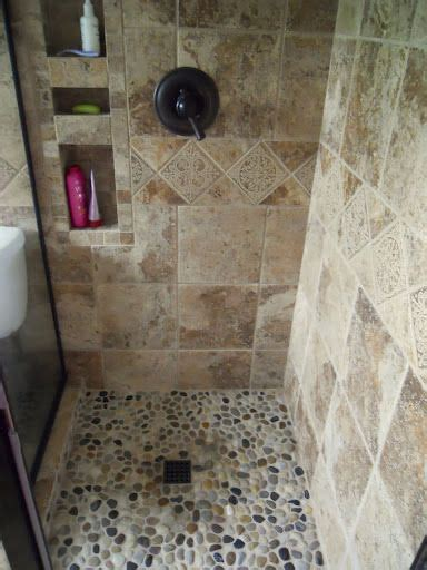 rock flooring bathroom 25 best ideas about river rock shower on pinterest