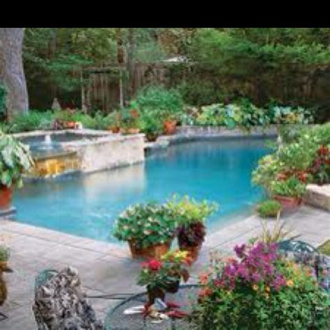 love all the potted plants around the pool gives it a
