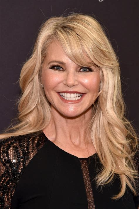 colleen christy chopped hairstyle christie brinkley long wavy cut with bangs long wavy cut