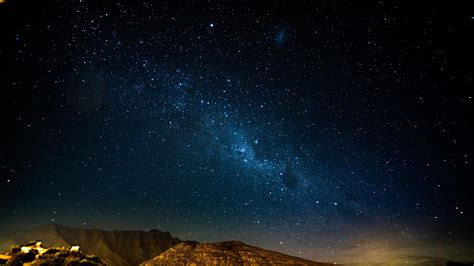wallpaper starry sky night mountains radiance glitter