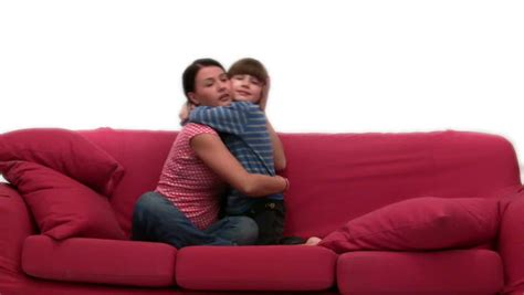 mom son couch young boy eating cotton candy stock footage video 488944