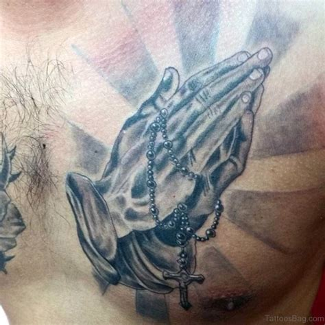 praying hands tattoo on chest 51 stylish praying tattoos on chest