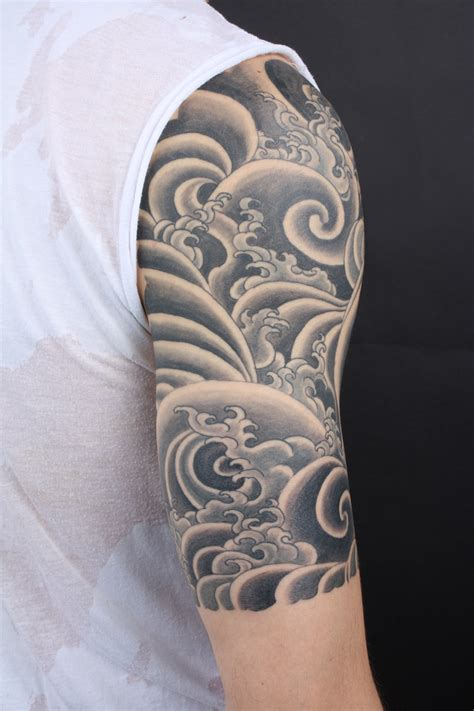 black sleeve tattoo designs black and gray water half sleeve tibetan style wave