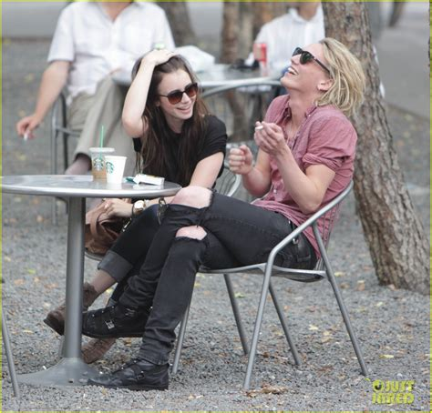 lily collins  jamie campbell bower spotted holding hands  toronto tmi source