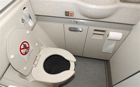 how to use airplane bathroom this is how airplane toilets work