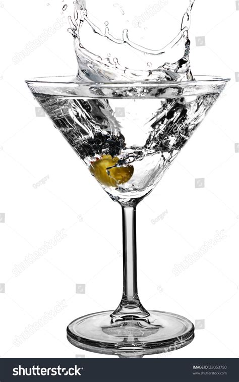 martini glass background cocktail olive splash on martini glass stock photo