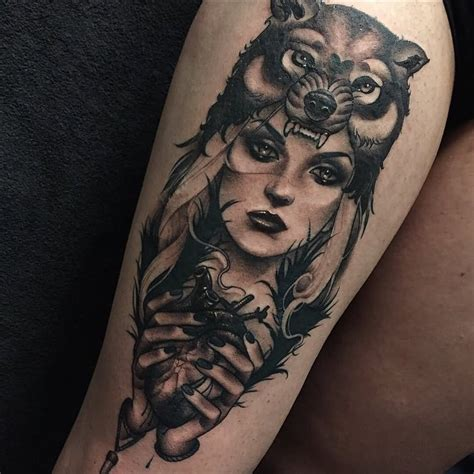 girl tattoos on thigh wolf on side thigh