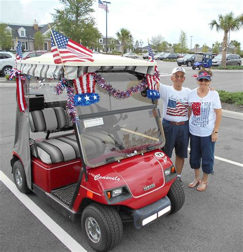 villagers decorate golf carts with patriotic themes for - Golf Carts Decorated For