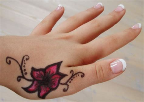 tattoos for women on wrist and hand tattoo on hand