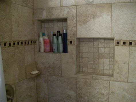 offset inset shelves in the porcelain tile shower for