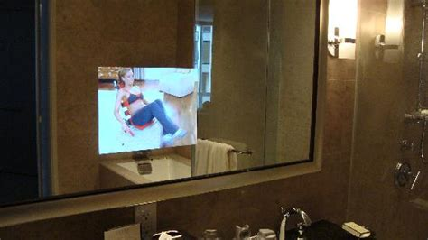 bathroom mirror with built in tv tv built into the mirror in the bathroom picture of