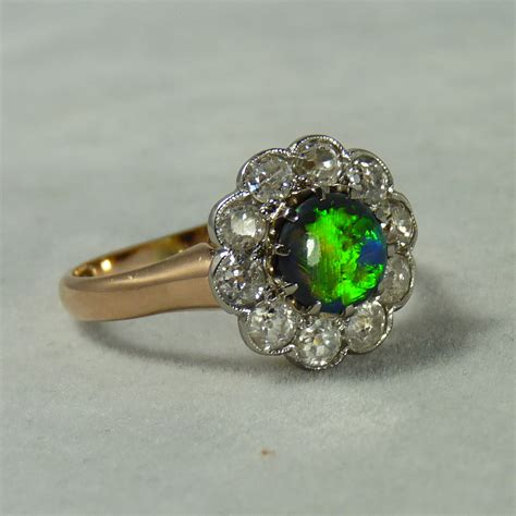 antique 1ct black opal ring with 1ct of diamonds