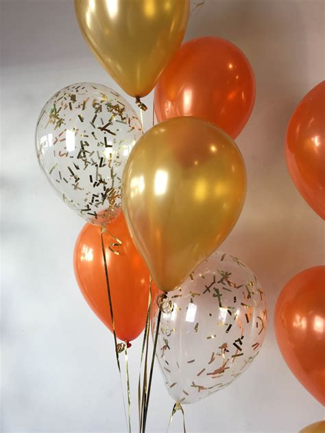 up a balloon with orange up rectangle confetti balloons with a mixture of
