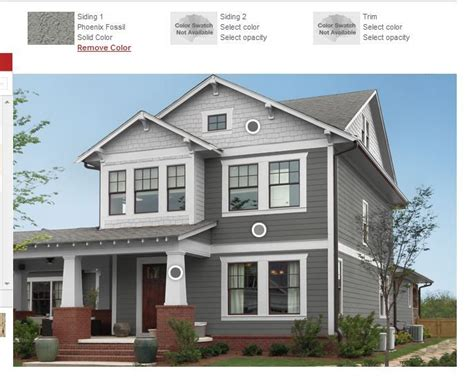 gray siding light gray wood shingle siding white craftsman style columns with brick base