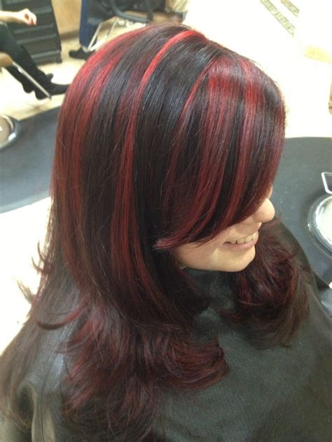 pictuted of red highlights on dark hair with spiky cut fun hair black with bold red highlights by joanna