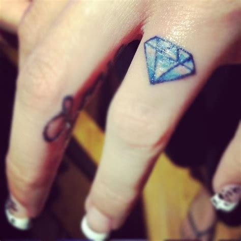 finger tattoo top the 25 best diamond finger tattoo ideas on pinterest