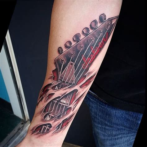 ripped skin 3d realistic guitar tattoo on lower sleeve