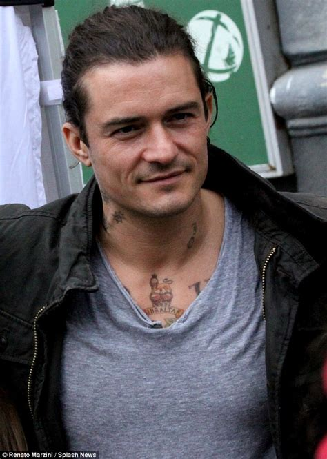 orlando bloom tattoo orlando bloom looks rather chilly on unlocked set with