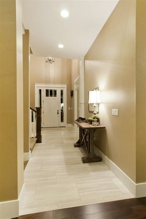 Light tile with a seamless transition to dark wood floor