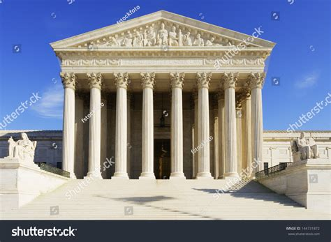 The United States Supreme Court Is Accessible To The by The United States Supreme Court Building Stock Photo