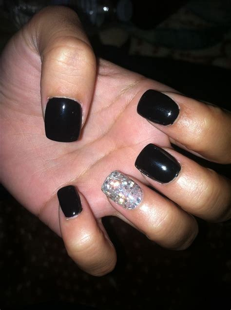one black fingernail black gel nails with one silver glitter nail nails