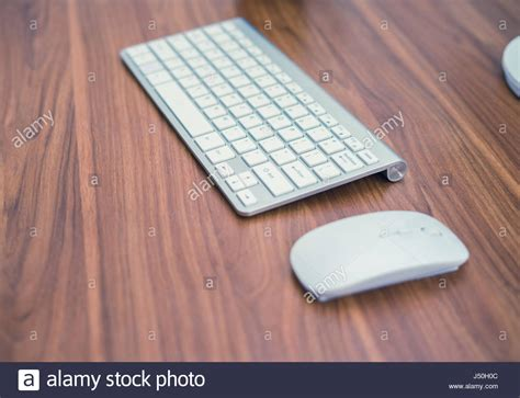 Keyboard And Mouse Table For by White Wireless Keyboard And Wireless Mouse On The Wooden