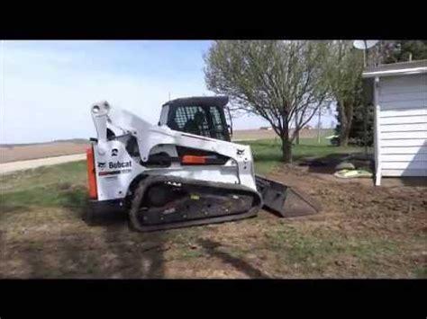 bobcat t870 compact track loader ctl grading yard